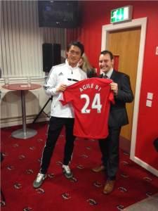 Tom receiving the Southampton FC football shirt
